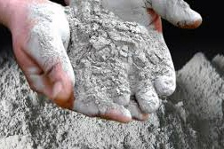 A man holding cement in his hand